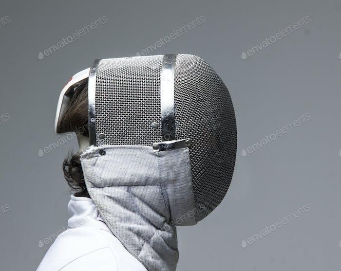 Profil eines Fechts in Fechtmaske