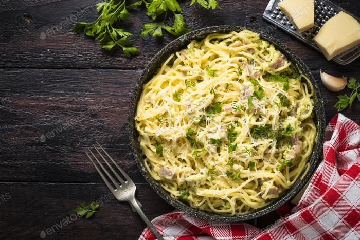 Pasta carbonara with bacon and cream sauce top view.