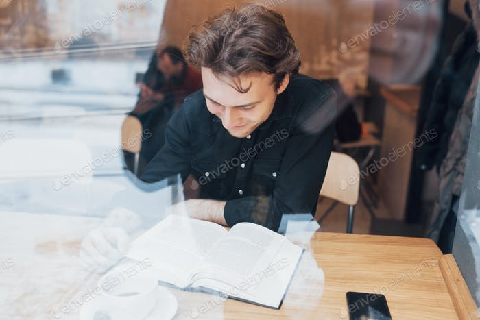 Young entrepreneur working in a cafe