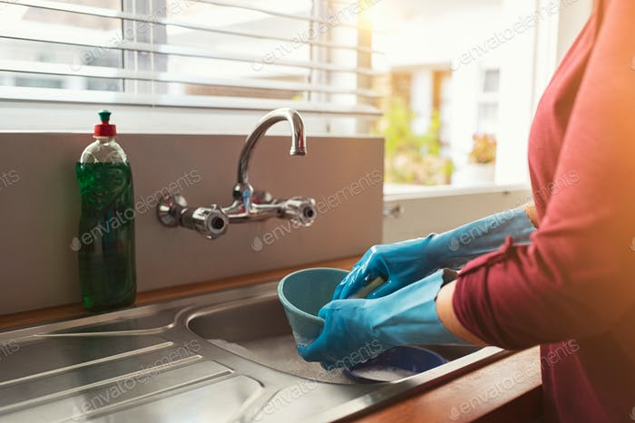 Woman hands washing dishes