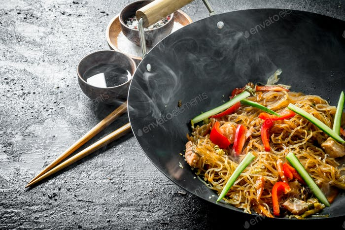 Chinese wok. Hot Asian cellophane noodles in a frying pan wok.