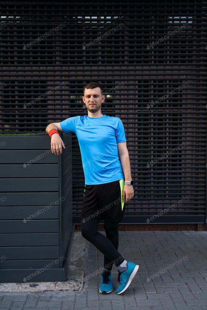 Sporty man portrait over gray background