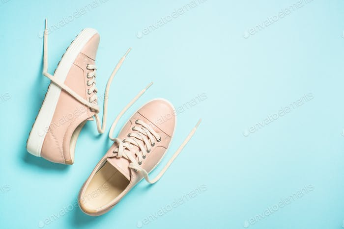 Woman fashion pink shoes on blue background