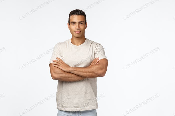 Self-assured and motivated good-looking male athlete in casual t-shirt, cross arms over chest in