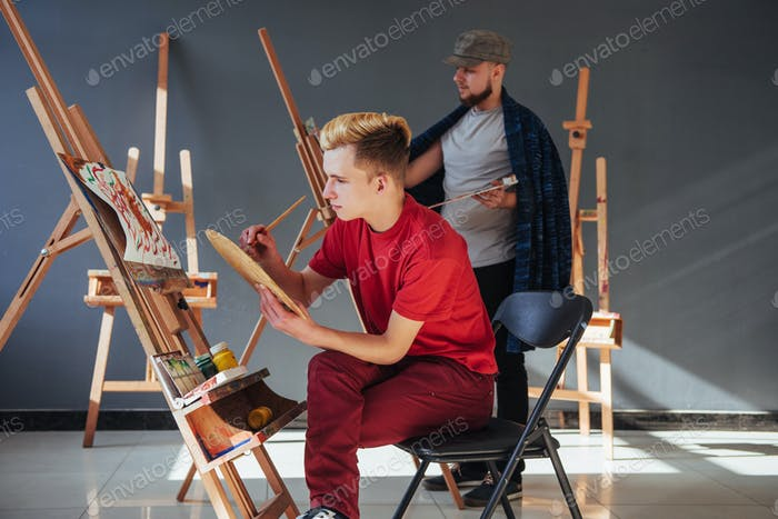 Creative artists have designed a colorful picture painted on canvas with oil paints in the studio