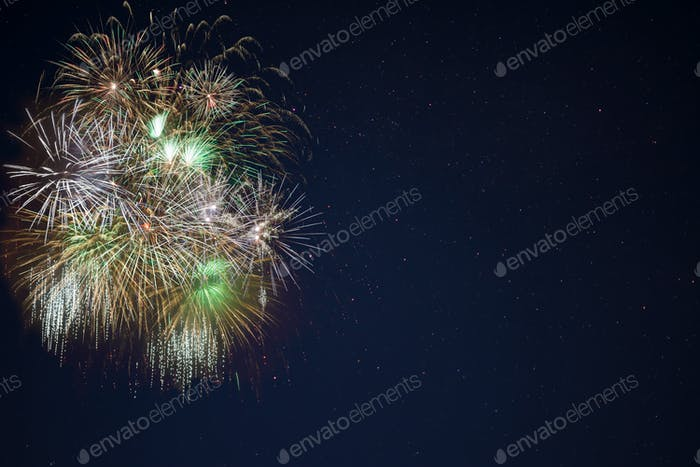 Golden green yellow fireworks located left side