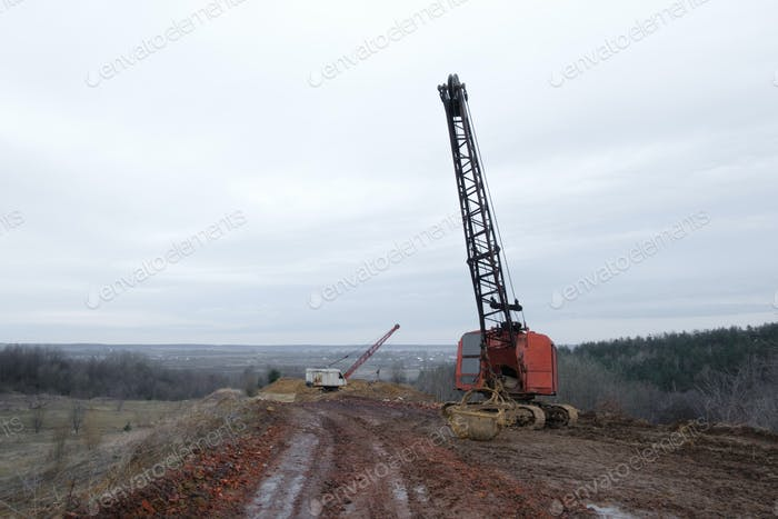 Thumbnail for Excavators in the red clay quarry