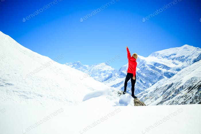 Woman success climbing on mountain peak