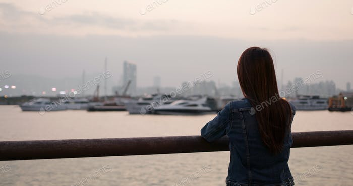 Woman look at the sea view in sunset time