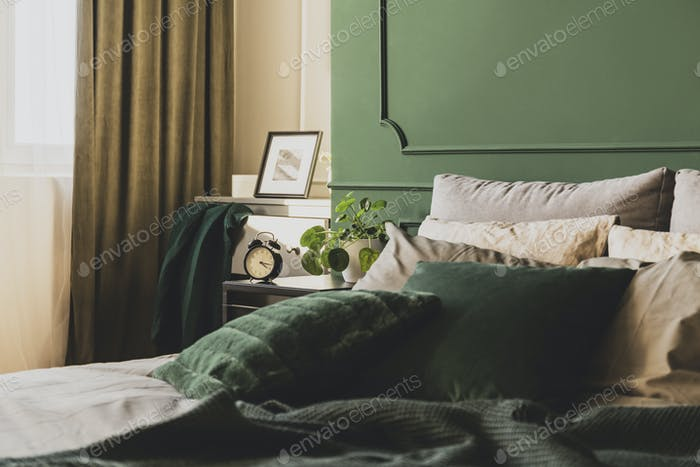 Dark green trendy interior design in fashionable apartment, copy space on empty wall