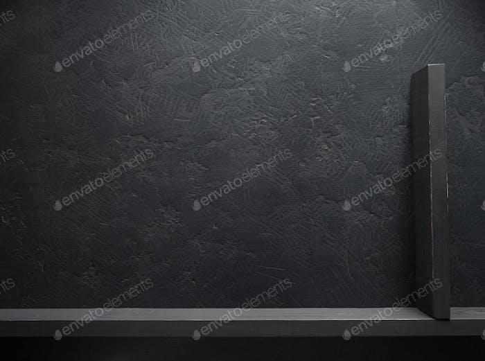 wooden shelf at black background