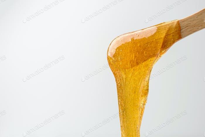Liquid sugar wax on spatula