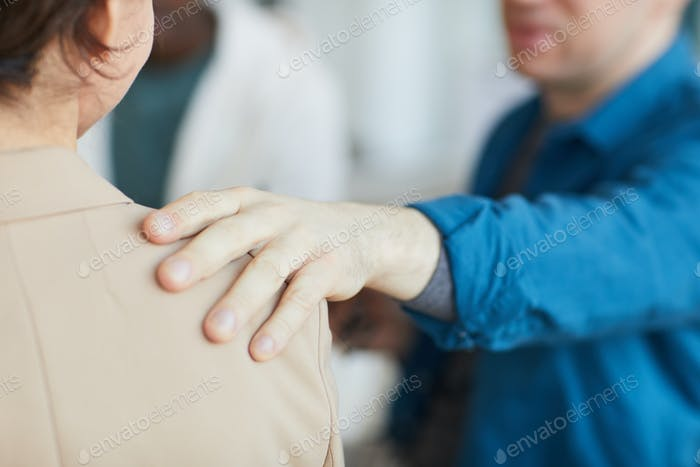 Comforting Gesture Hand on Shoulder