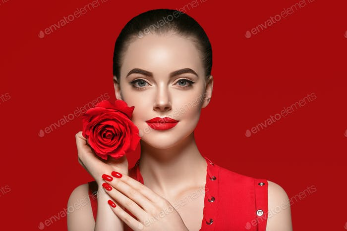 Woman with rose flower. Beauty female portrait with beautiful rose flower and salon hairstyle.