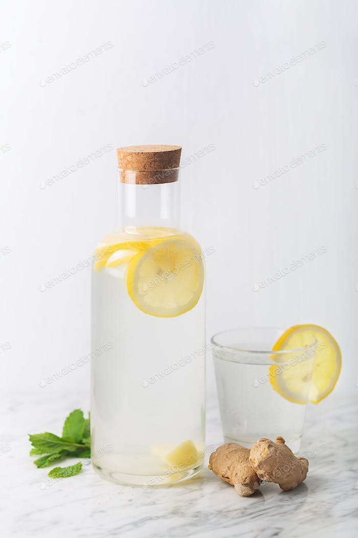 Ginger Water with Lemon and Honey in a Glass Bottle, Vertical Orientation