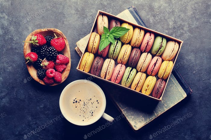 Colorful macaroons, berries and coffee