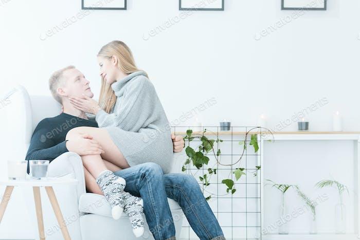 Woman sitting on man's laps