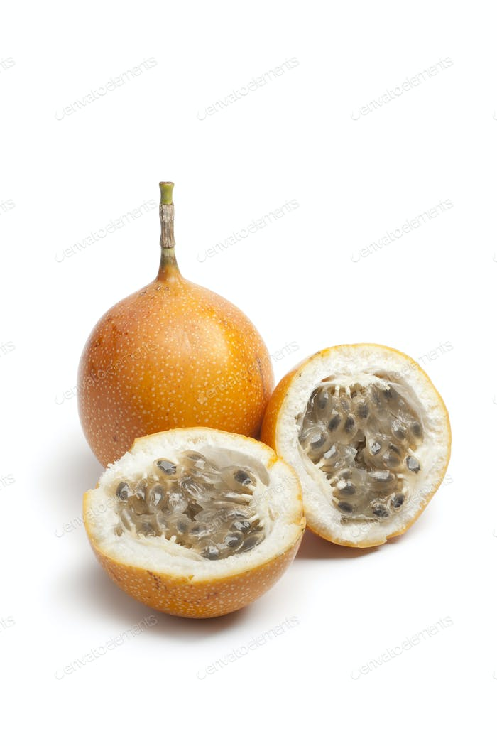 Whole and partial orange passion fruit