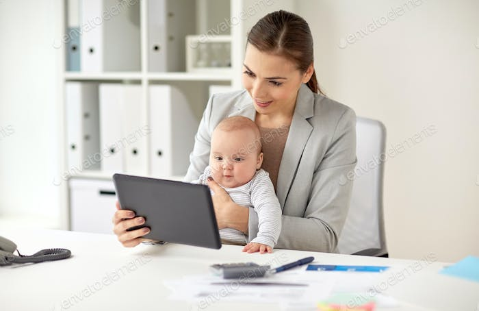 businesswoman with baby and tablet pc at office