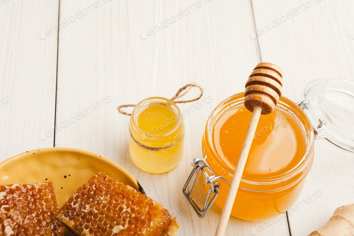 Various types of honey on white wooden background, closeup