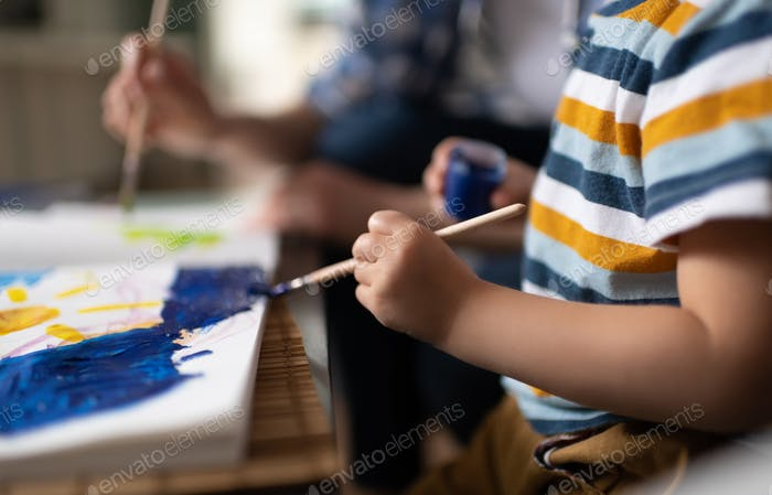 Child using painting with parent at home