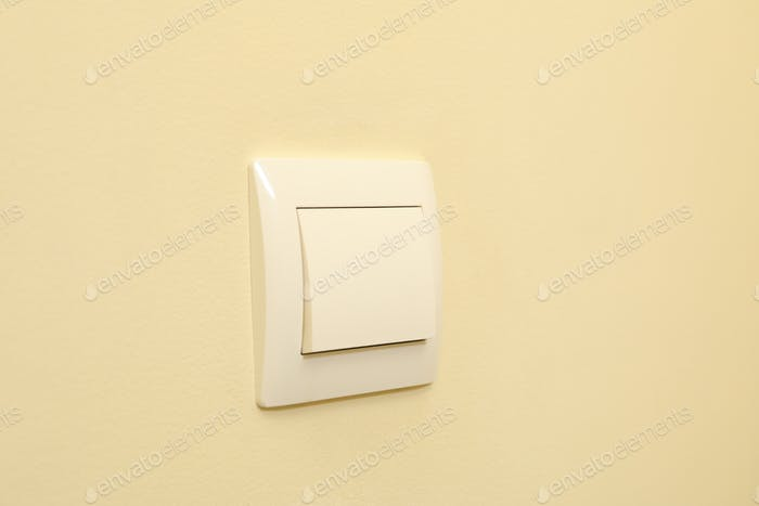 On-Off light switch on the beige wall