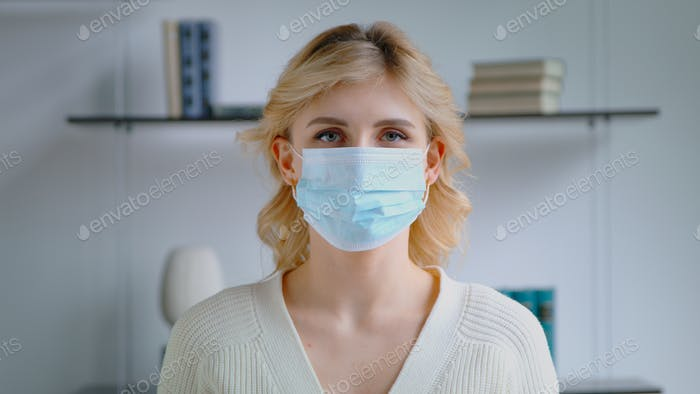 Young woman in a medical mask
