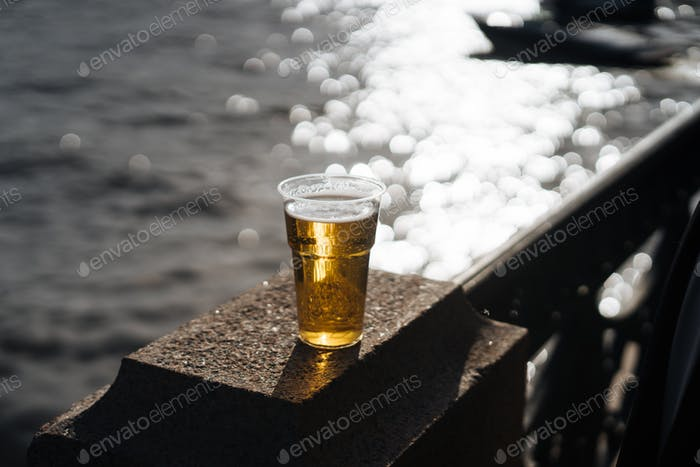 beer in cup on riverfront