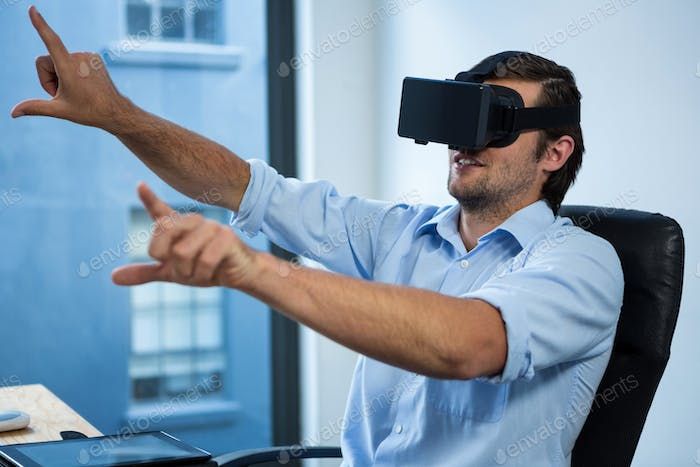 Thumbnail for Businessman using virtual reality headset at desk