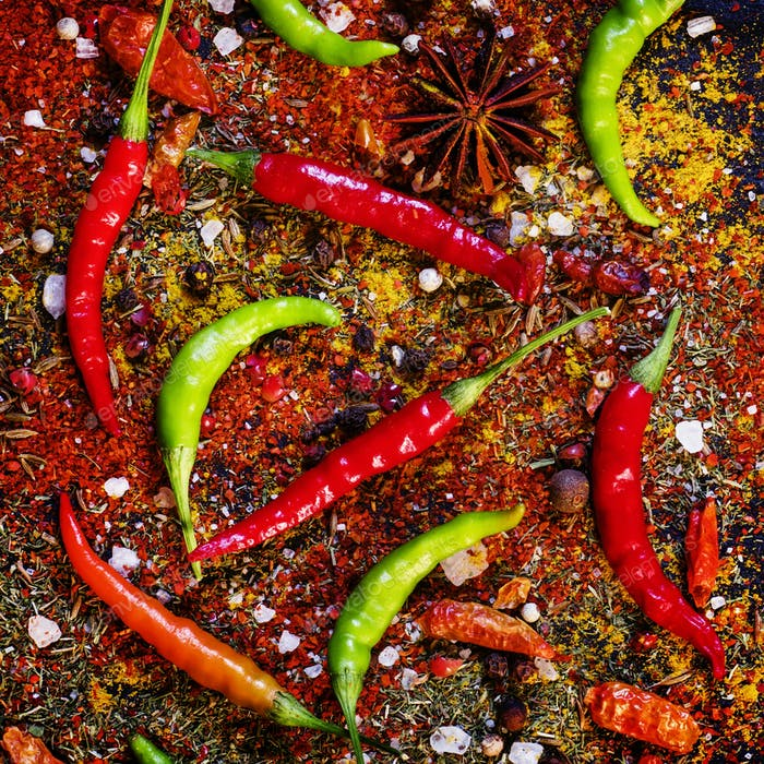 Spices and spicy chili peppers, top view