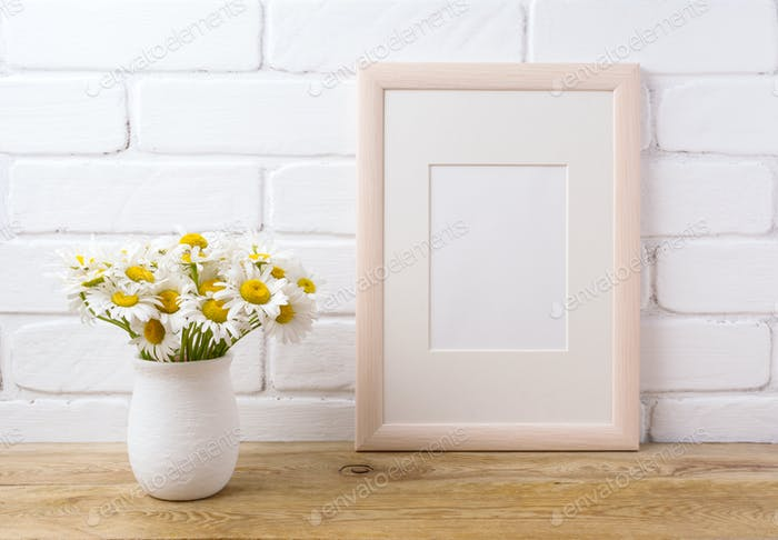 Wooden frame mockup with chamomile bouquet in rustic vase