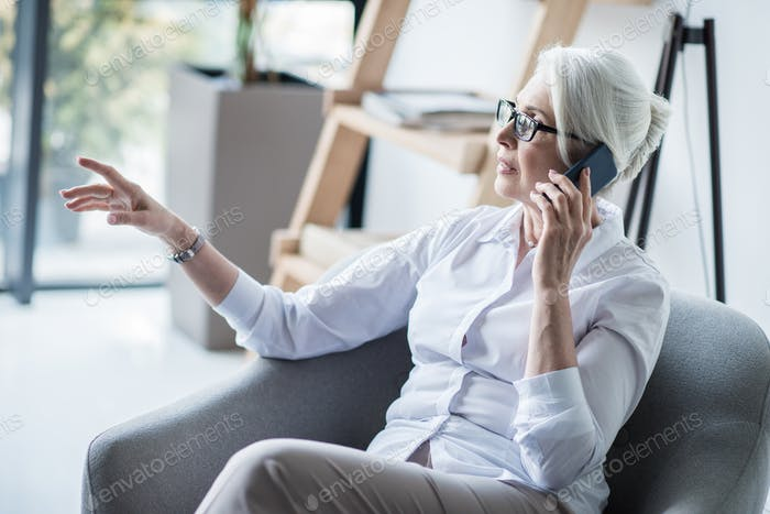 Senior business woman talking on phone