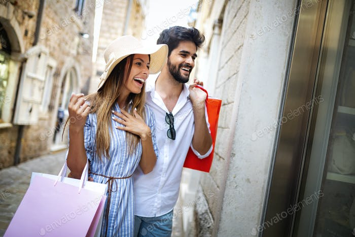 Beautiful happy couple enjoy travel and shopping together at summer