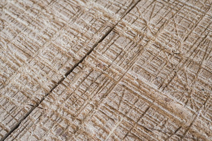 Grunge scratched and drilled wooden surface texture.