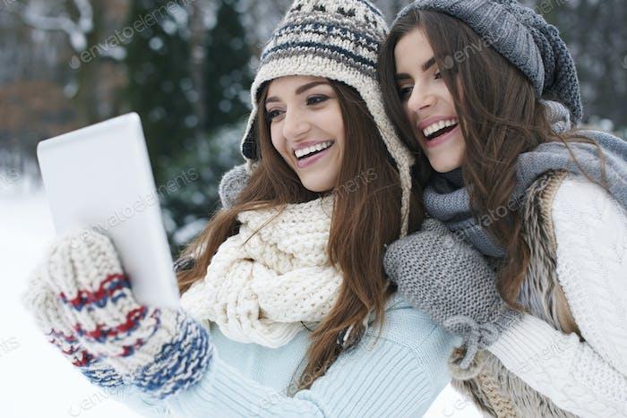 Sharing their online photo album in winter day