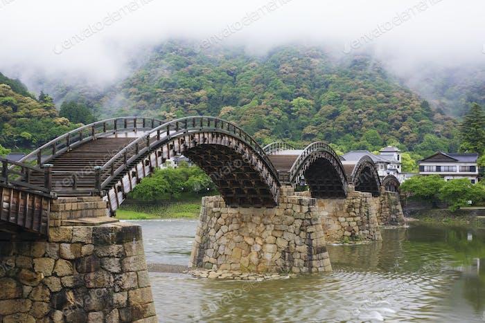 Asian Pedestrian Bridge Over a River