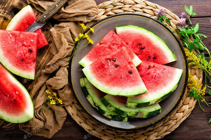 Watermelon. Fresh watermelon slices on plate on wooden rustic background