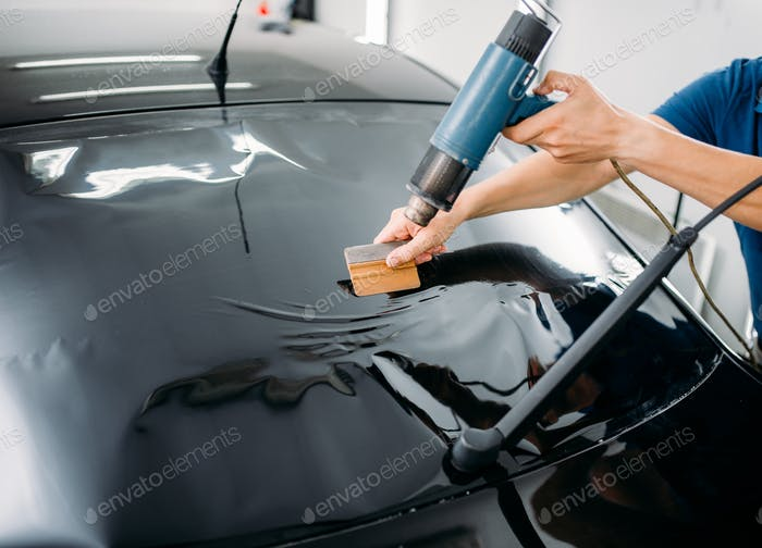 Specialist with drier, tinting film installation
