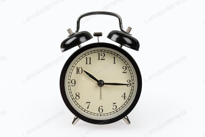 black alarm clock isolated on white