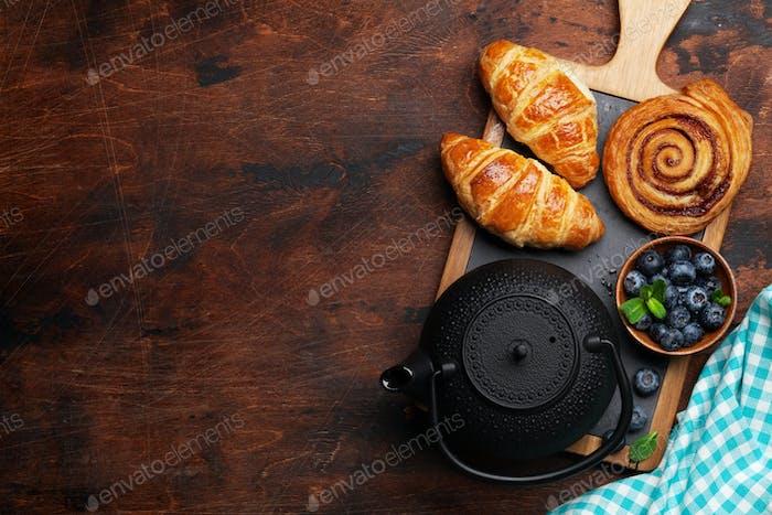 Tea and croissants breakfast