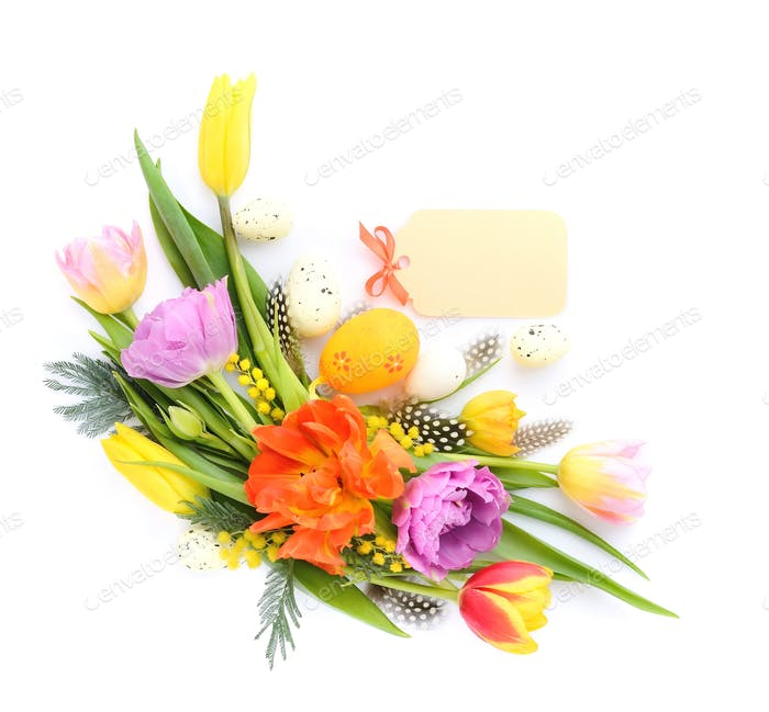 Colorful tulips with easter eggs on white background. Top view.