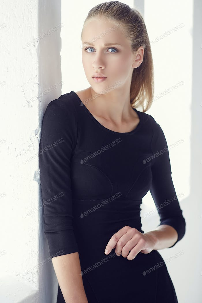 Portrait of slim young woman in black t shirt.