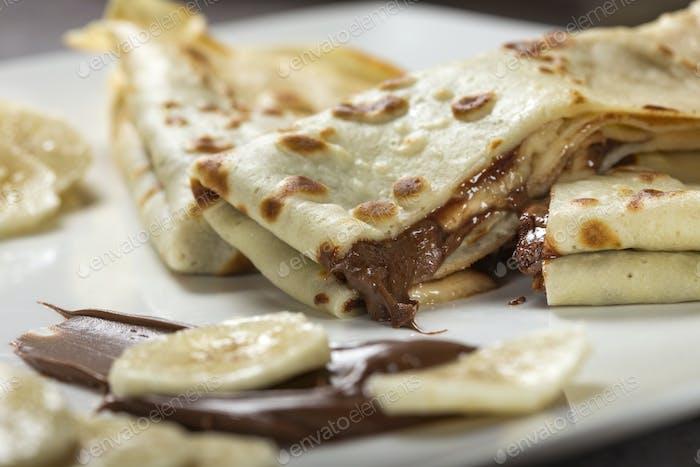 crepes with banana and chocolate sauce