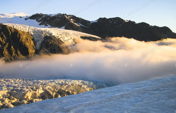 Clouds Roll in Over the Fox Glacier During Sunset in New Zealand
