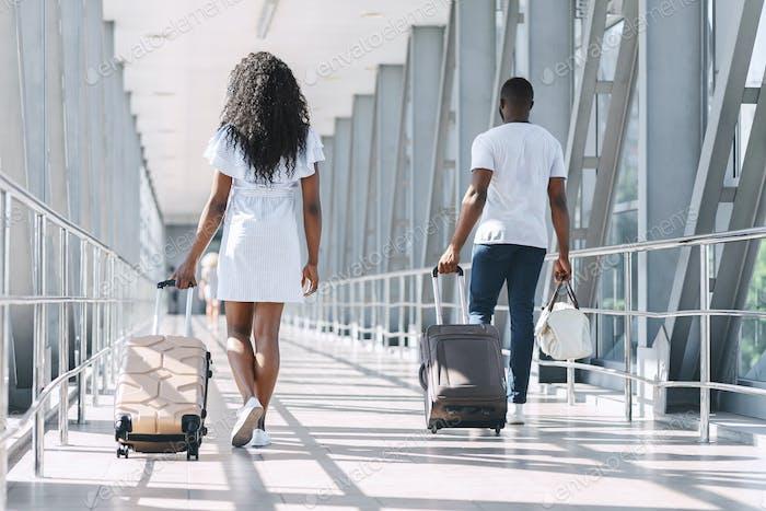 Terminal walkway with walking to flight departure passengers