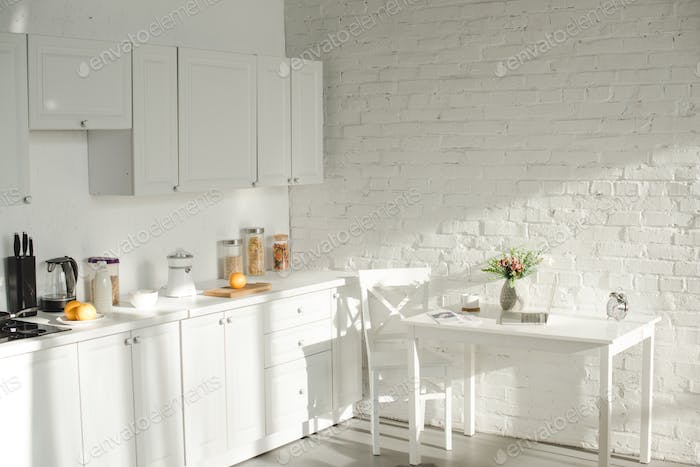 sunlight in white modern kitchen with cooking utensils