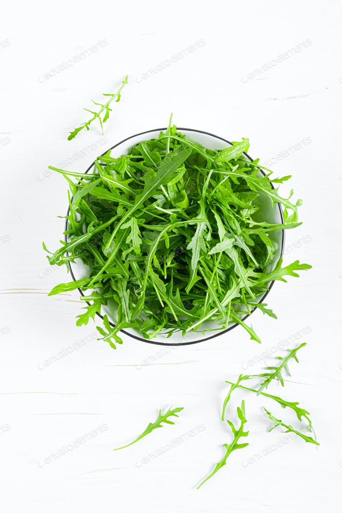 Fresh arugula or rocket leaves salad, rucola, top view