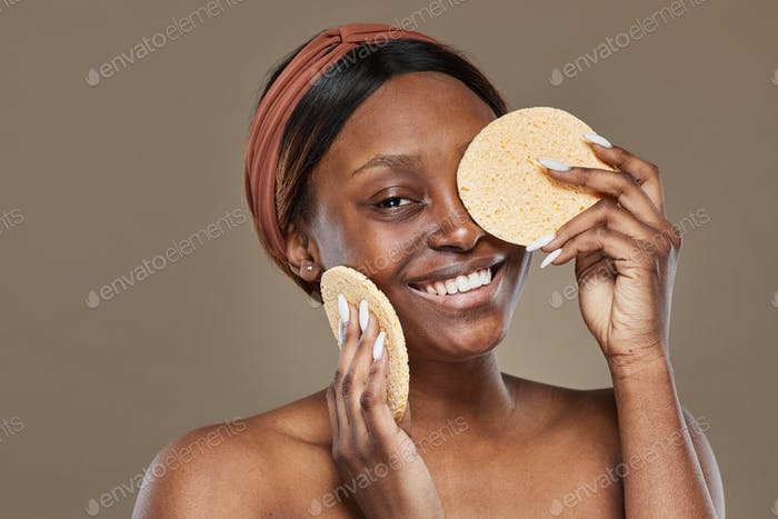 African American Woman Holding Sponge