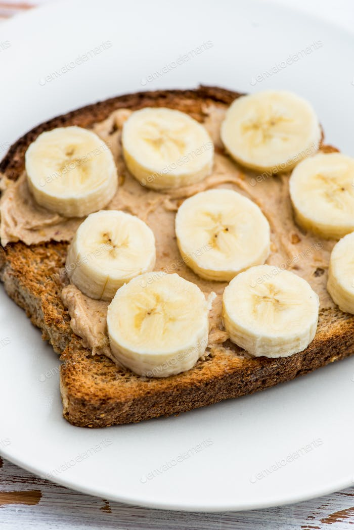 Toasts from Wholewheat Bread with Peanut Butter and Banana