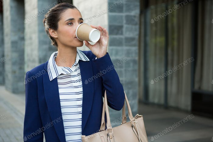 Business executive drinking coffee